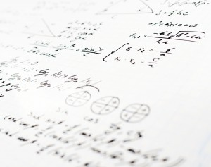 Squared sheet of paper filled with trigonometry math equations and formulas as a background composition with the shallow depth of field